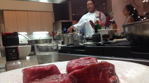 Chef Younger instructing the class on cooking a filet.
