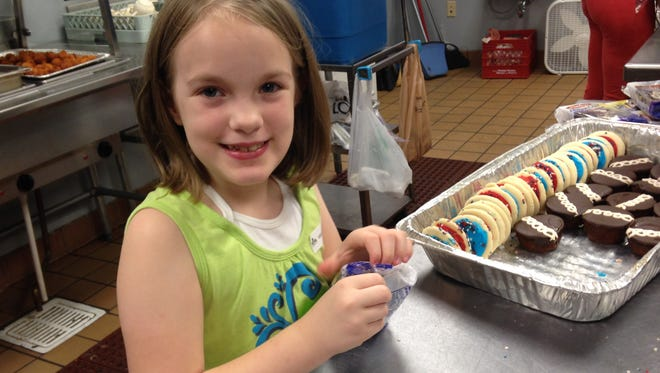 Zetta Coleman, who will soon turn 9, wanted to serve in RIFA's soup kitchen as her birthday wish.