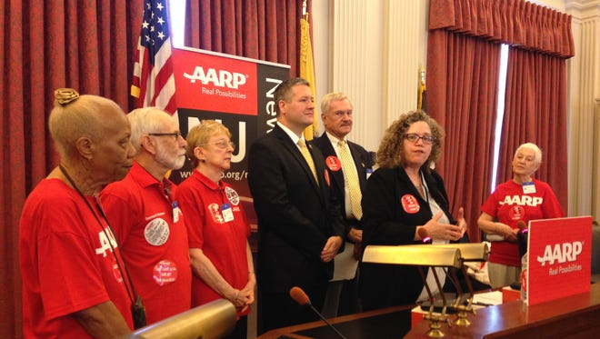 Evelyn Liebman, AARP New Jersey's associate state director for advocacy, discusses legislation that would put a moratorium on the replacement of copper landline telephone networks with wireless on June 16, 2014 at the Statehouse Annex in Trenton, N.J. Liebman is joined by AARP volunteers, Assemblyman Daniel Benson and AARP's chief utilities advocate Ken Lindhorst.
