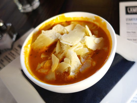 Roasted tomato soup with shaved gouda cheese at Lamp