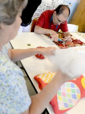 Tommy sews during an AngelWorks Day Program activity at Holy Angels in Shreveport.