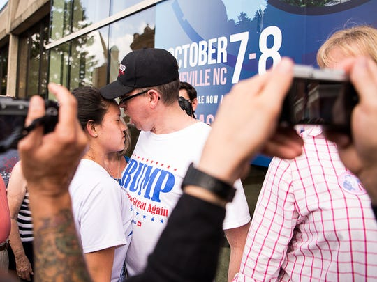 A Donald Trump supporter screams at a young protestor, who did not wish to be identified, while in line to enter the U.S. Cellular Center Monday Sept. 12, 2016. Trump is scheduled to speak at 6 p.m.