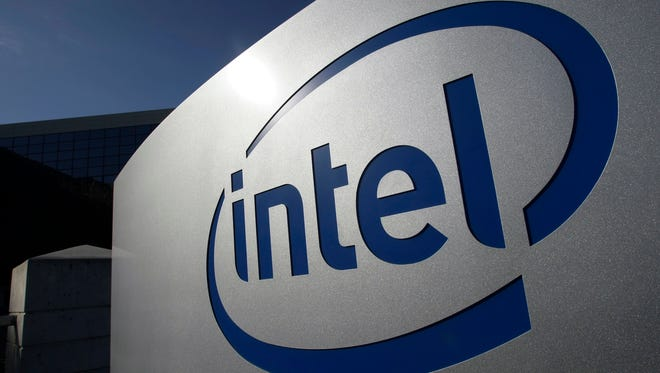 Intel shares surged Friday after the company announced an increased revenue forecast Thursday.
