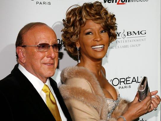 Music mogul Clive Davis and singer Whitney Houston