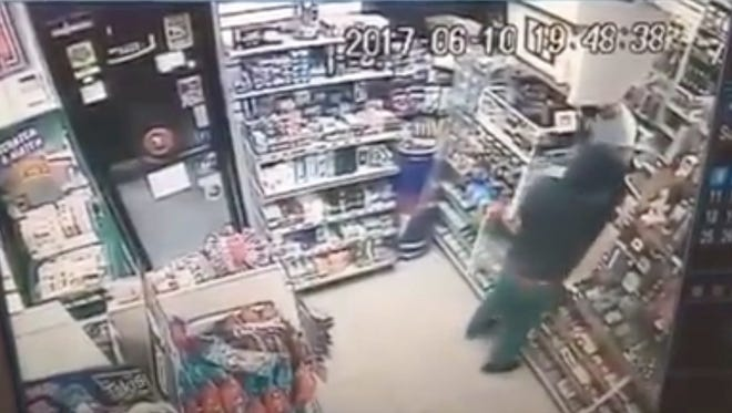 Authorities released this screen shot from surveillance video of the Rose Supermarket robbery.