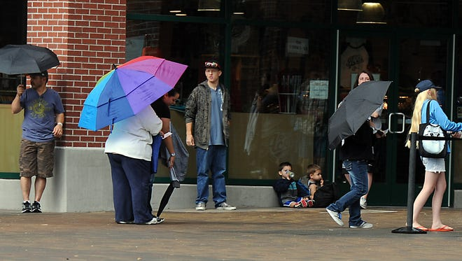 Umbrellas  were prevalent for those attending the Reno Aces baseball game Tuesday July 8, 2014.