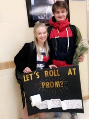 "Penfield High School junior Kylie Truelson, right, immediately following her ""Let's Roll at Prom?"" promposal from Penfield High School junior Max Scorzelli this month at the school and she said yes."