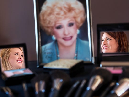 Mary Kay National Sales Director Dawn Otten-Sweeney, right, and her daughter Mary Kay Independent Sales Director Auldon Sweeney-Wydo are seen in makeup cases near a photo of company founder Mary Kay Ash at Dawn's home in Canton on Oct. 8, 2014.