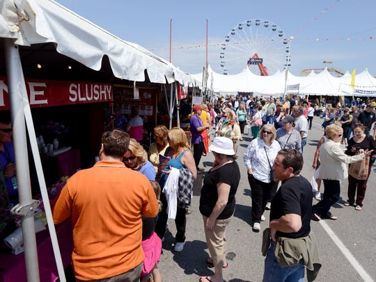 Bright sunshine casts it's rays on festival goers at