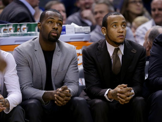 Indiana Pacers Rodney Stuckey, left, and Monta Ellis sit in street clothes on the bench during the first half of their game Monday, Dec. 19, 2016,  at Bankers Life Fieldhouse.