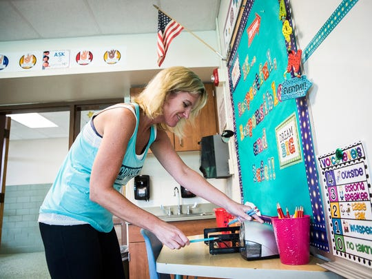 Amanda Seale sharpens pencils in her classroom at West