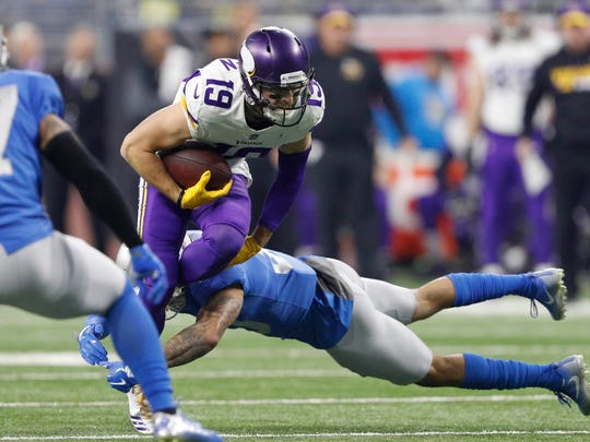 Lions cornerback Teez Tabor (30) tries to tackle Vikings wide receiver Adam Thielen (19) during the first quarter at Ford Field.