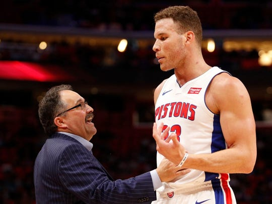 Pistons coach Stan Van Gundy talks with forward Blake Griffin during the third quarter against the Bucks at Little Caesars Arena.