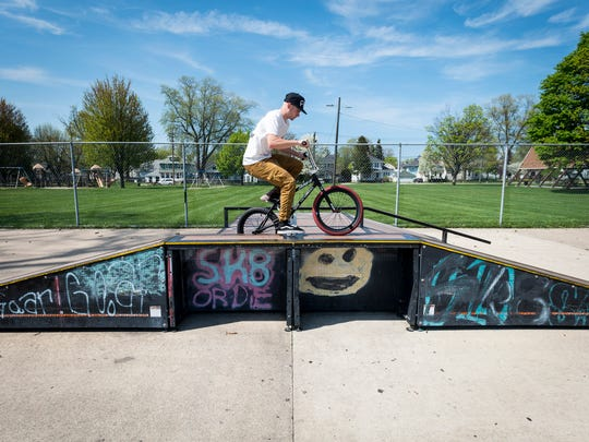 Dougie Rutherford does tricks on his BMX bike at the Optimist Park skate park Wednesday, May 18. Rutherford says he prefers to ride at Optimist Park because of the ramps.