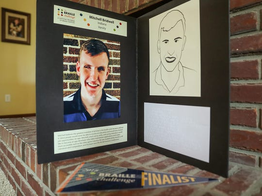 A poster board displays a biography and picture of Mitchell Bridwell that was displayed at the Braille Challenge recently, seen at his family's home in Pittsboro, Ind., Thursday, July 12, 2018. The 17-year-old recently won the Braille Challenge varsity championship for the second consecutive year at the University of Southern California. Bridwell will be a senior at the Indiana School for the Blind and Visually Impaired this fall.