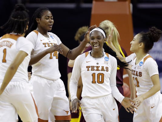 Texas guard Lashann Higgs (10) celebrates a score with teammates Alecia Sutton (1), Olamide Aborowa (14) and Brooke McCarty (11) during a second-round game in the NCAA women's college basketball tournament against Arizona State, Monday, March 19, 2018, in Austin, Texas. (AP Photo/Eric Gay)