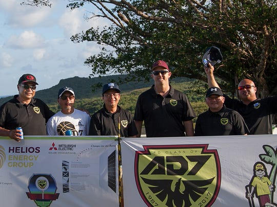 Members of the FDMS class of 1987 behind one of their banners at the inaugural Par Tree Golf Tournament at the Country Club of the Pacific last year.