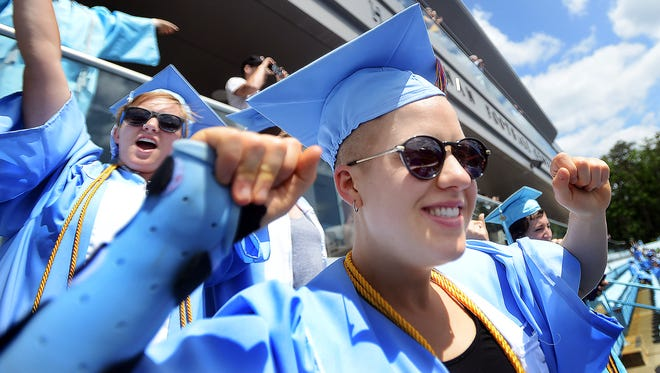 Students celebrate graduation day at the University of North Carolina-Chapel Hill in May 2013.