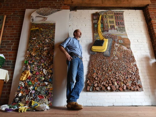 Zanesville artist Paul Emory with a pair of his 3-dimensional