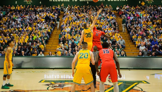 Vermont's Payton Henson (35) and Stony Brook's Junior Saintel (11) battle for the opening tip off during the America East men's basketball semifinal game between the Stony Brook Seawolves and the Vermont Catamounts at Patrick Gym on Tuesday night March 6, 2018 in Burlington.
