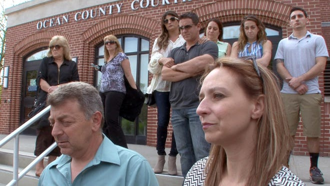 Christine and Ronald Holt are joined by family members outside the Ocean County Courthouse in Toms River Monday, May 23, 2016. They had brought a civil suit against Anthony and Melissa Senatore, the parents of the 4-year-old who fatally shot their 6-year-old Brandon.