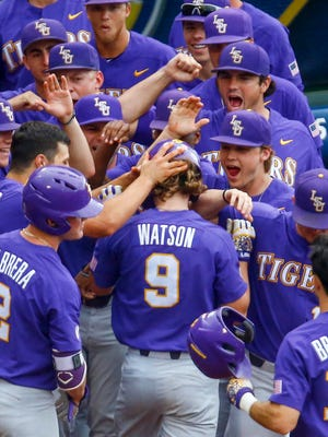 LSU's Zach Watson (9) celebrates with teammates after hitting a two-run home run during the sixth inning of a Southeastern Conference tournament NCAA college baseball game against Arkansas, Saturday, May 26, 2018, in Hoover, Ala. (AP Photo/Butch Dill)