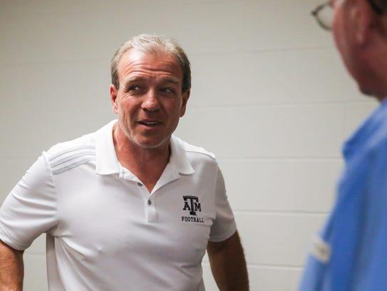 Texas A&M University head coach Jimbo Fisher chats