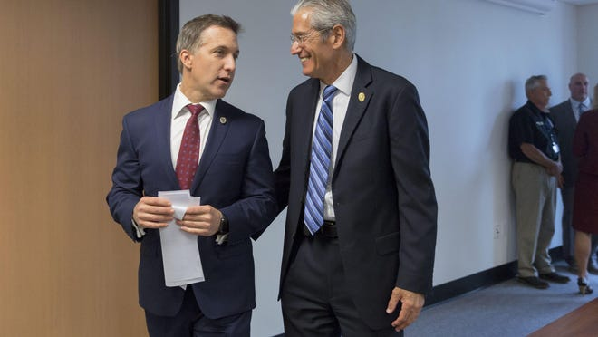 State Attorney Dave Aronberg (left) and Chief Assistant State Attorney Al Johnson talk following a press conference announcing the arrests of 15 people in a multi-state drug treatment fraud investigation on April 2, 2019 in West Palm Beach, Florida.