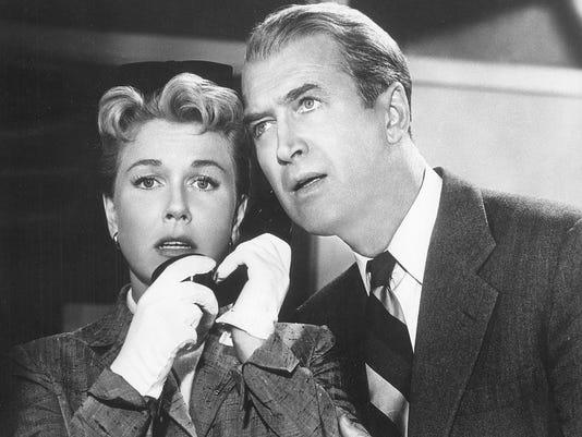 4. Doris Day and Jimmy Stewart in a publicity still from The Man Who Knew To