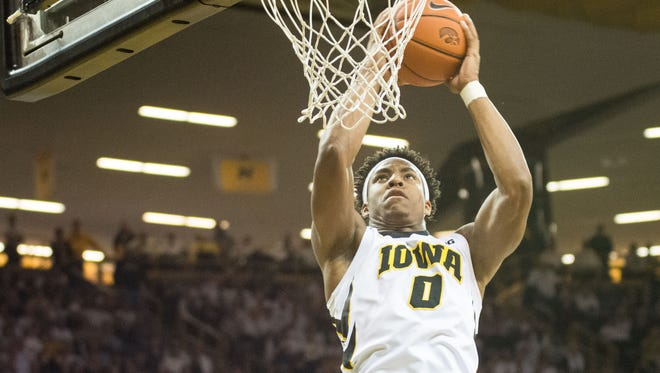 Ahmad Wagner grabs a rebound during the second half of the Hawkeyes' win.