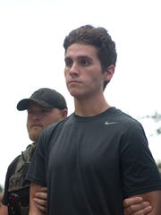 Austin Harrouff arrives at the Martin County Sheriff's Office to be processed into the Martin County Jail on Oct. 3, 2016, in Stuart.