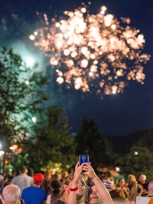 A couple takes a selfie during the fireworks July 4, 2016.