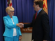 Greg Stanton and Thelda Williams shake hands at Stanton's resignation on May 29, 2018. Williams will serve as the interim mayor.