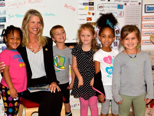 Florida State Senator Debbie Mayfield reads to students