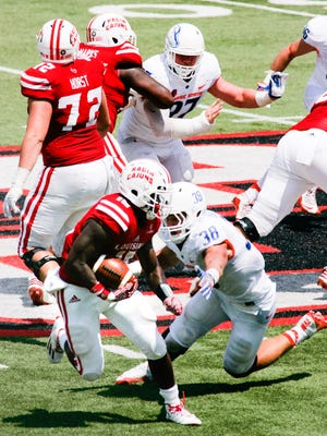UL right tackle Grant Horst (72) blocks on the back side for running back Elijah McGuire rushes against Boise State earlier this season.