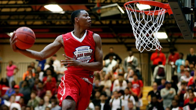April, 1, 2016; Pearland, Texas; Troy Baxter dunks in the finals of the slam contest during the American Family High School Slam and 3-point championship at Dawson High School.