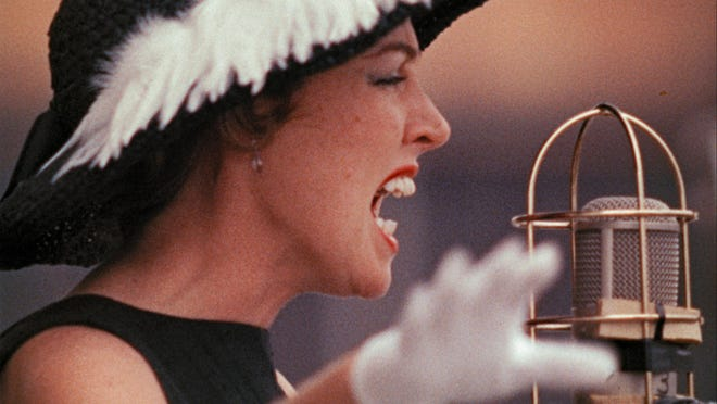 """Anita O'Day performs at the 1958 Newport Jazz Festival, captured in the recently restored documentary """"Jazz on a Summer's Day,"""" available for streaming through Kino Marquee."""
