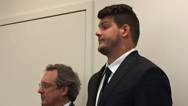Former Michigan football captain Taylor Lewan, right, and his attorney.