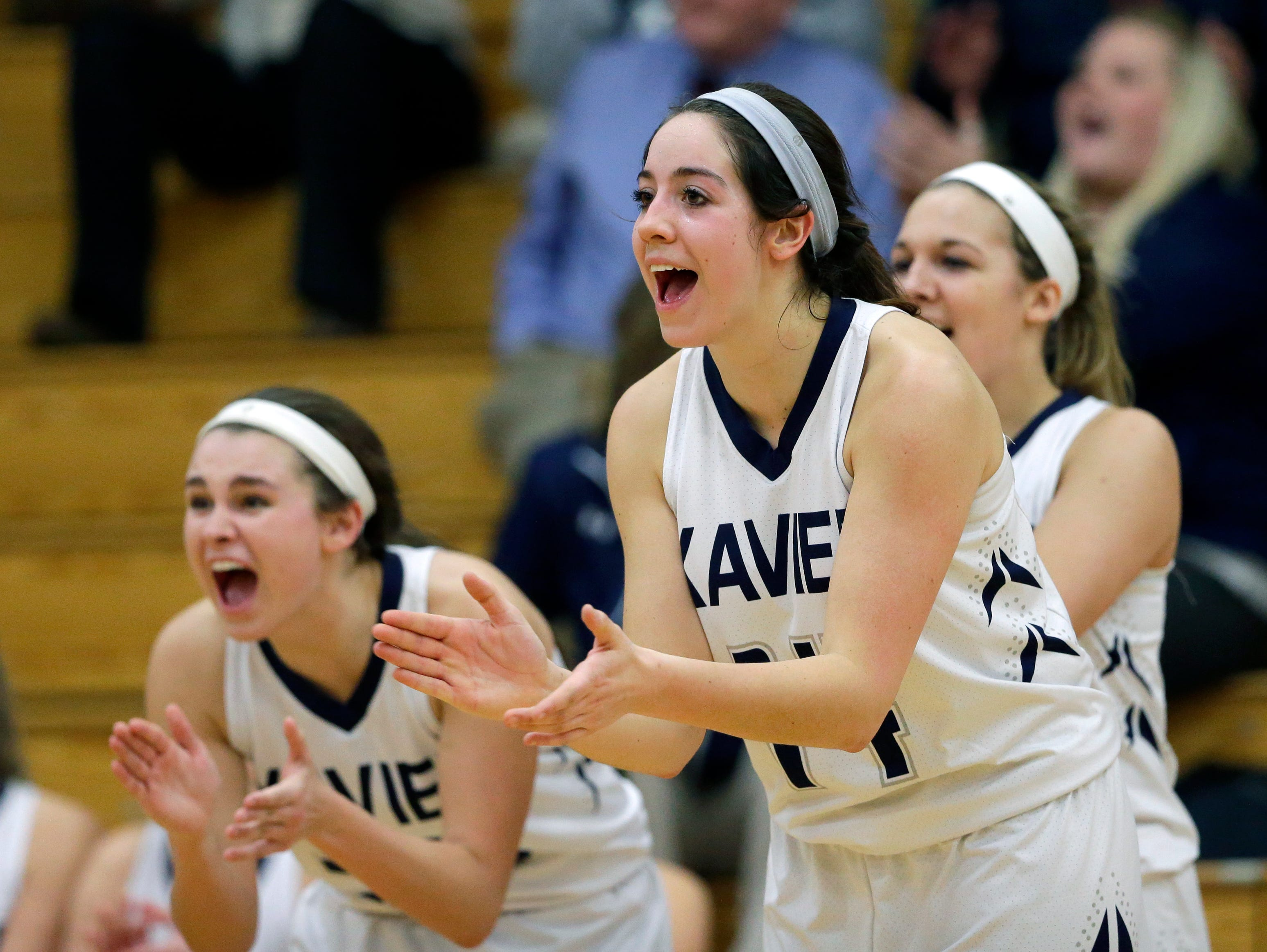 Xavier's Erin Powers (right) and others cheer for their teammates during a comeback run against Seymour in a Bay Conference girls' basketball game Feb. 18 in Appleton.