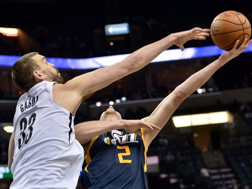 Utah Jazz forward Joe Ingles (2) shoots against Memphis Grizzlies center Marc Gasol (33) during the second half of an NBA basketball game Wednesday, Feb. 7, 2018, in Memphis, Tenn. (AP Photo/Brandon Dill)