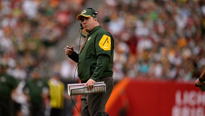 Green Bay Packers head coach Mike McCarthy shows his frustration against the Tampa Bay Buccaneers during Sunday's game at Raymond James Stadium.