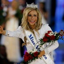 Miss New York Kira Kazantsev, right, walks the runway after she was named Miss America 2015 on Sept. 14, 2014, in Atlantic City, N.J.