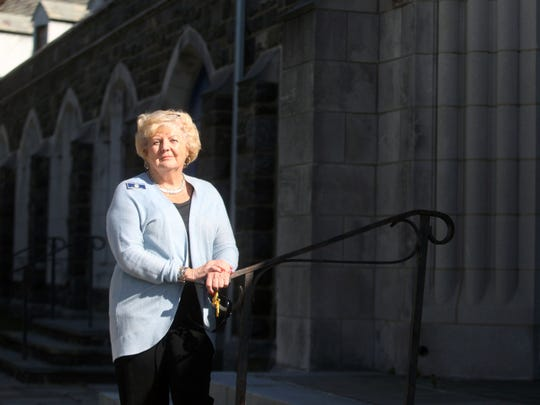 Priscilla B. Rakestraw, development director at the Ministry of Caring,  stands outside the Cathedral Church of St. John in Wilmington. A 100-year-old lectern was stolen from the church.