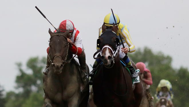 Cloud Computing, second from left, ridden by Javier Castellano, wins the 142nd Preakness Stakes horse race ahead of Classic Empire, ridden by Julien Leparoux.