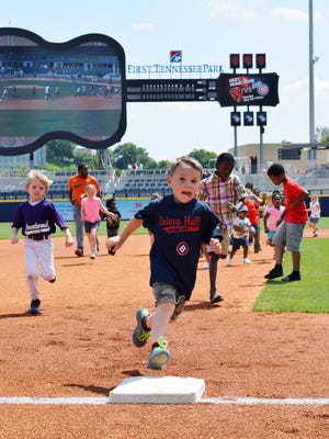 Kids running the bases at Nashville Sounds' First Tennessee Park during a past game.