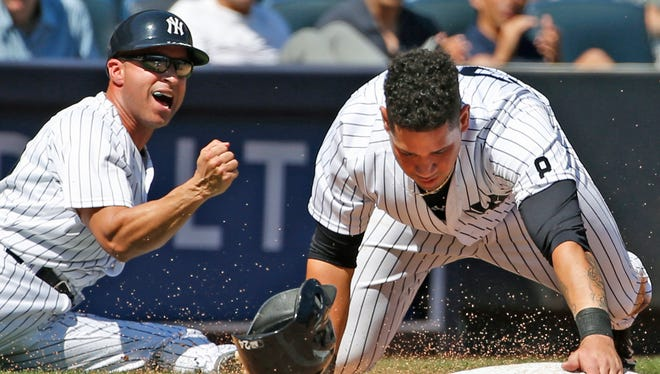 New York Yankees third base coach Joe Espada (53) reacts after New York Yankees designated hitter Gary Sanchez was tagged out trying to reach third from first on Mark Teixeira's fourth-inning single in a baseball game against the Baltimore Orioles in New York, Sunday, Aug. 28, 2016.