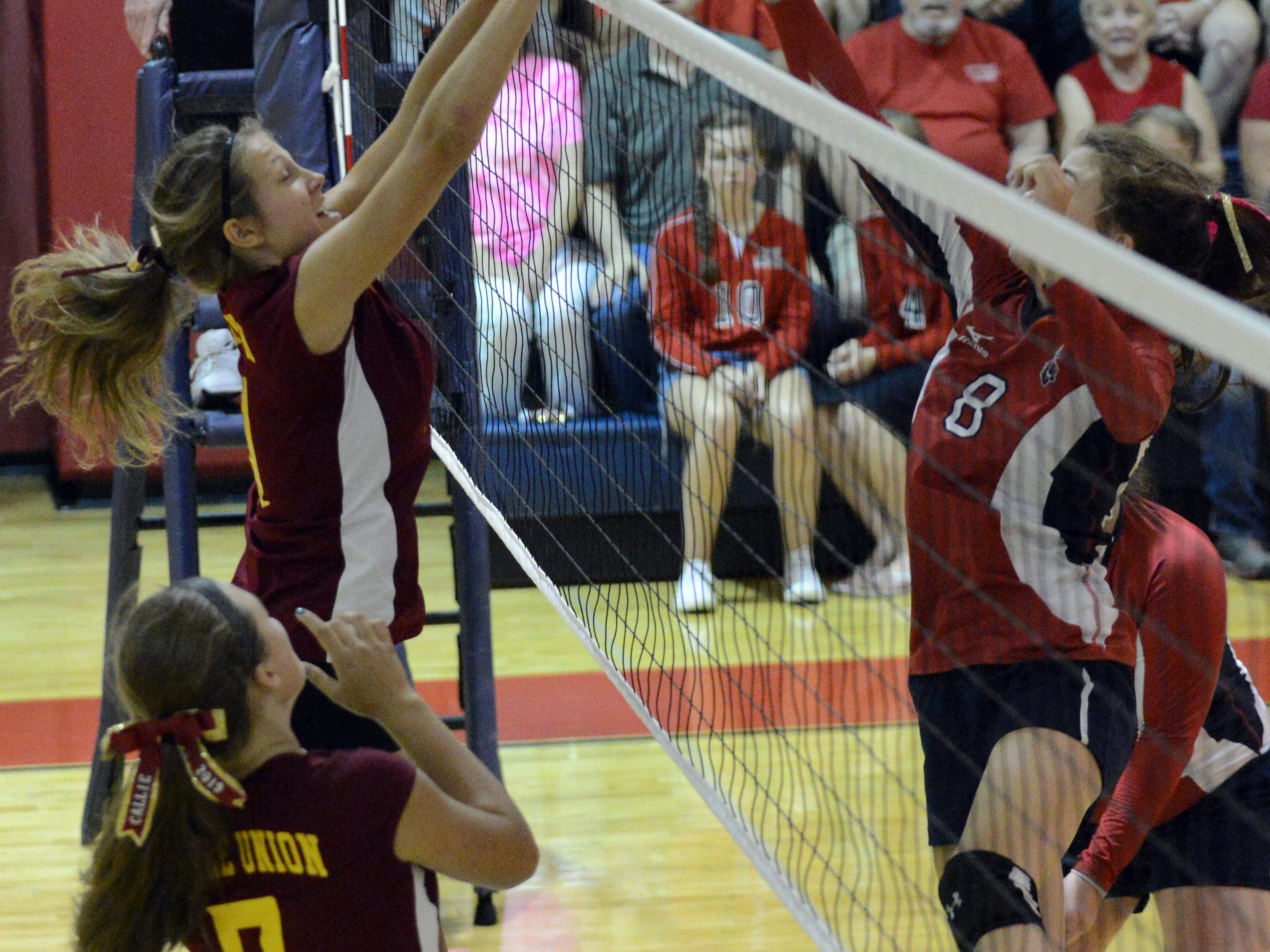 Berne Union's Lauren Shepherd, left, tips the ball over the net against Fairfield Christian's Blaire Barr on Thursday night at Fairfield Christian Academy in Lancaster. The Rockets won the match three games to two.