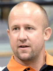 Central High School football coach Josh Oswalt enters