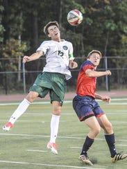 Delbarton's Mark Forbes (12) heads the ball away from
