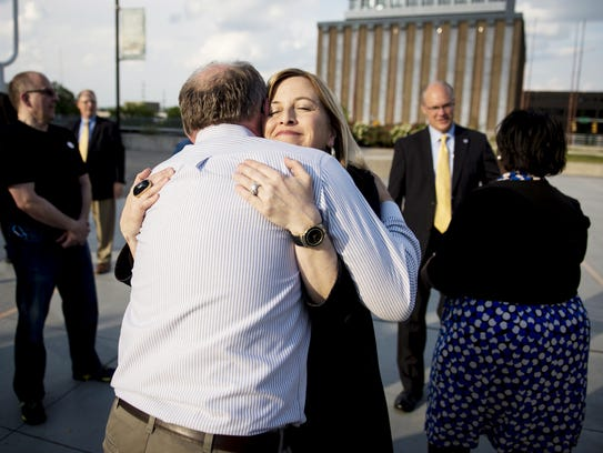 Mayor Megan Barry hugs Tom Ward of the Oasis Center